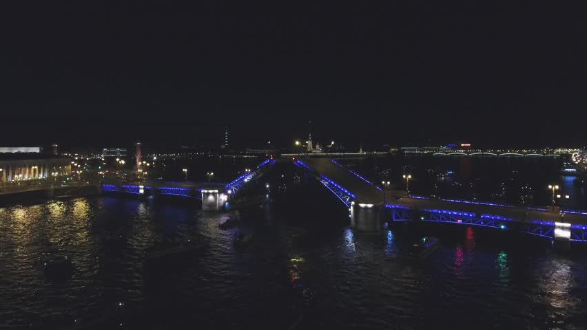 Flight over St. Petersburg. Movable bridges in St. Petersburg. Drawbridges  in St. Petersburg. Flight over drawbridges in St. Petersburg. Evening flight in the city. | Shutterstock HD Video #1009742075