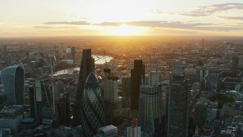 London UK - November 2017: Aerial view City of London sunset with sun flare financial district modern skyscrapers Gherkin Cheesegrater England United Kingdom RED WEAPON