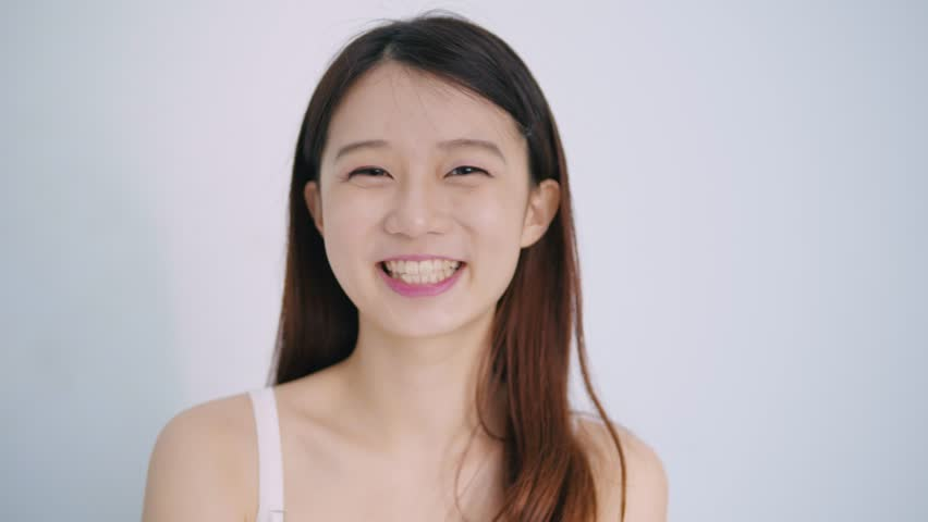 Woman smile happily on the white background