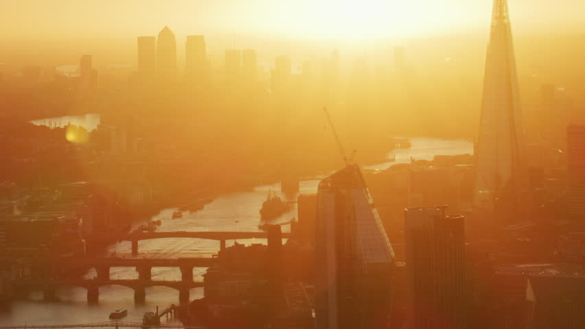 Aerial sunrise view morning sunshine over City of London skyline commercial skyscrapers and River Thames England United Kingdom RED WEAPON | Shutterstock HD Video #1009771625