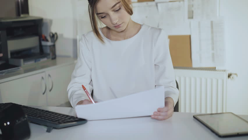 Busy girl works with diagrams and tablet in office. 4K. | Shutterstock HD Video #1009776815
