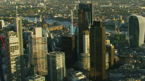 London UK - November 2017: Aerial view at sunset London cityscape financial district skyscrapers Walkie Talkie River Thames Tower Bridge England United Kingdom RED WEAPON