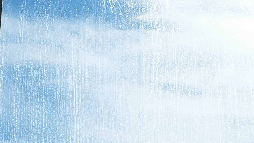 Hand washes the wiper with a dirty window from the outside close-up, slow motion | Shutterstock HD Video #1009811615