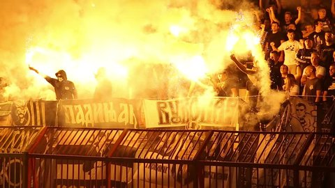 SERBIA, BELGRADE - April 15, 2018: Football fans during eternal rivals have met in the Eternal soccer derby, FC Partizan and Red Star from Belgrade, Conflict between the hooligans and police,