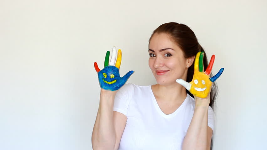Portrait student girl smiling girl show painted colorful hands with smiles. Concept education, creativity, art and painting. light white background. | Shutterstock HD Video #1009823885