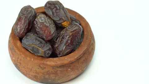 Delicious fresh organic palm dates over white background