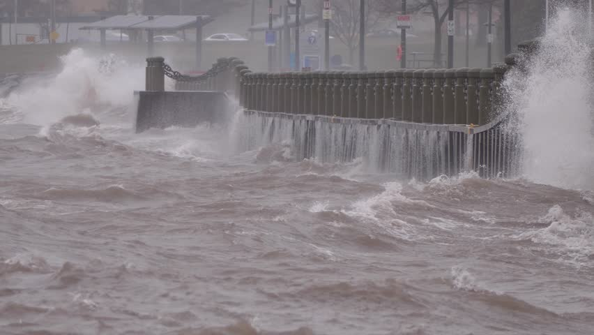 Massive waves crash into shore in typhoon and hurricane force wind storm  | Shutterstock HD Video #1009893605