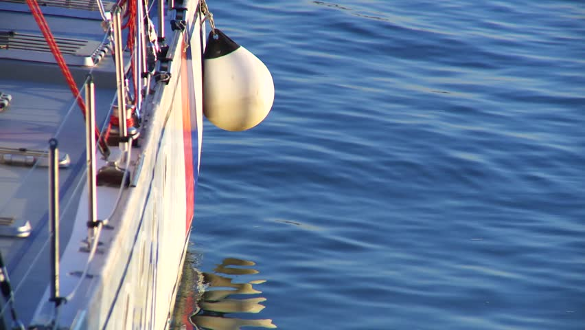 buoy hanging off the side of a yacht