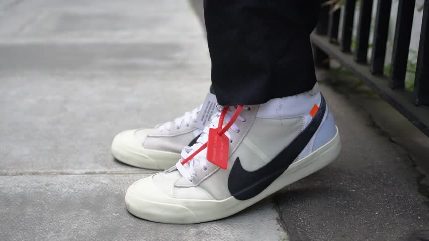 fef398e9 London / UK - February 11 2018: Man with Nike Off White Blazer Mid  Sneakers, street style in London