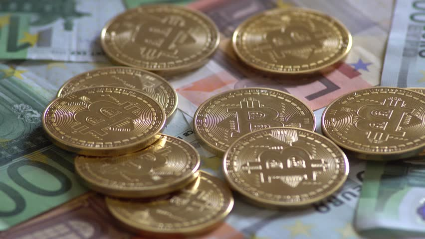 Golden Bitcoins And Euro Banknotes Rotating | Shutterstock HD Video #1009998635