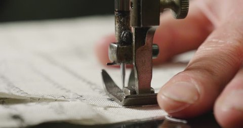 Tailoring. in ancient tradition of Italian tailors it is sewing a shirt . concept of tradition and Italian designer clothing.