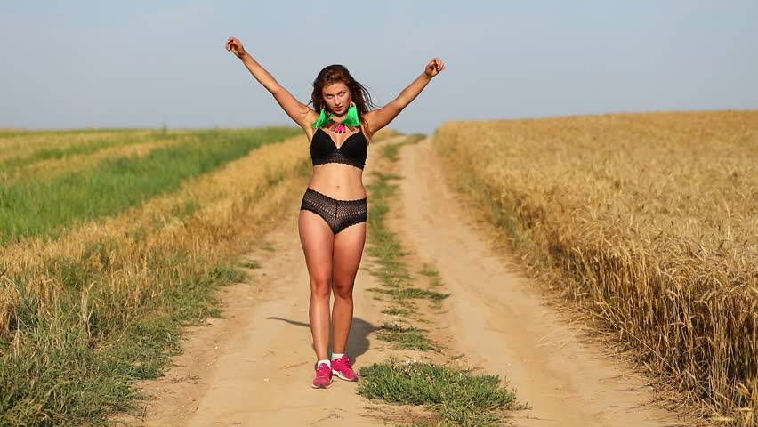 Dancer Woman. Young girl dances in a wheat field