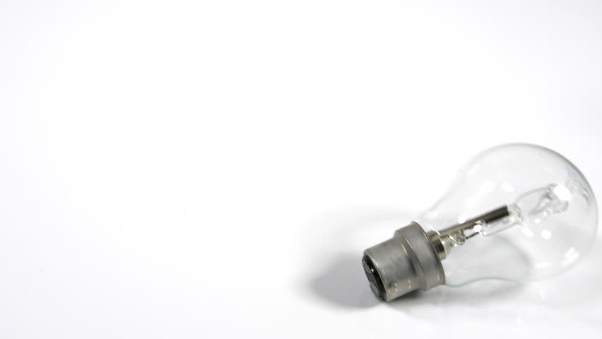 4K Light bulb rolling on white surface background, moving object, energy efficient tungsten lamp | Shutterstock HD Video #1010071745