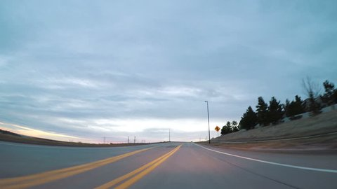 Time lapse. Driving on suburban road early in the morning.