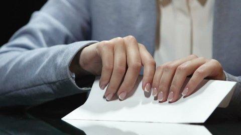 Man hands checking dollar bills in envelope, witness bribing, illegal salary