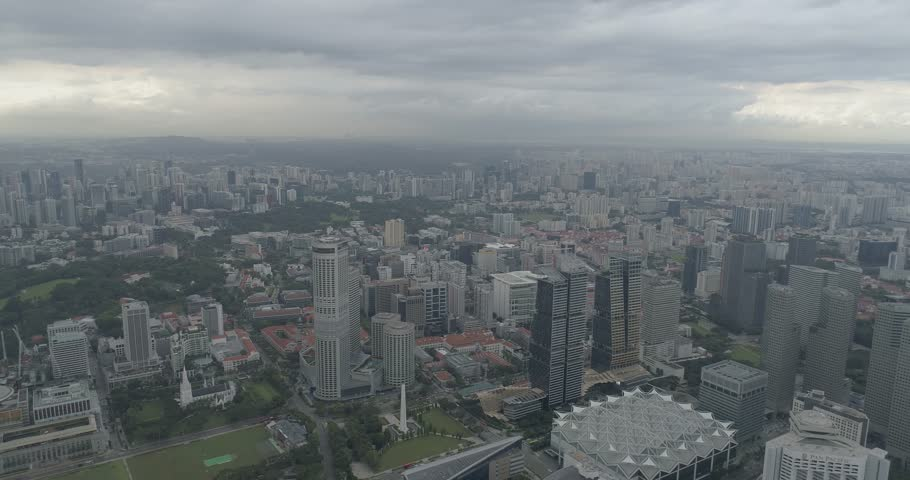 4k aerial footage of Singapore skyscrapers with city skyline during cloudy summer day | Shutterstock HD Video #1010131115