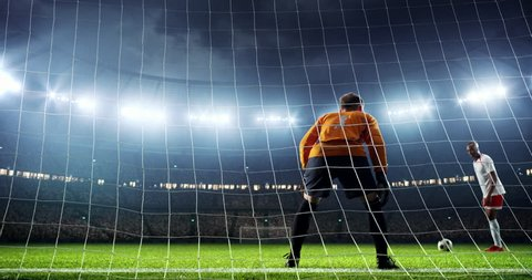 Soccer player fails to make a goal on a prefessional soccer stadium. Athlete wears unbranded sport clothes