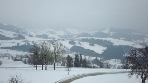 WS AERIAL POV Hilly landscape in winter / Neustift, Upper Austria, Austria