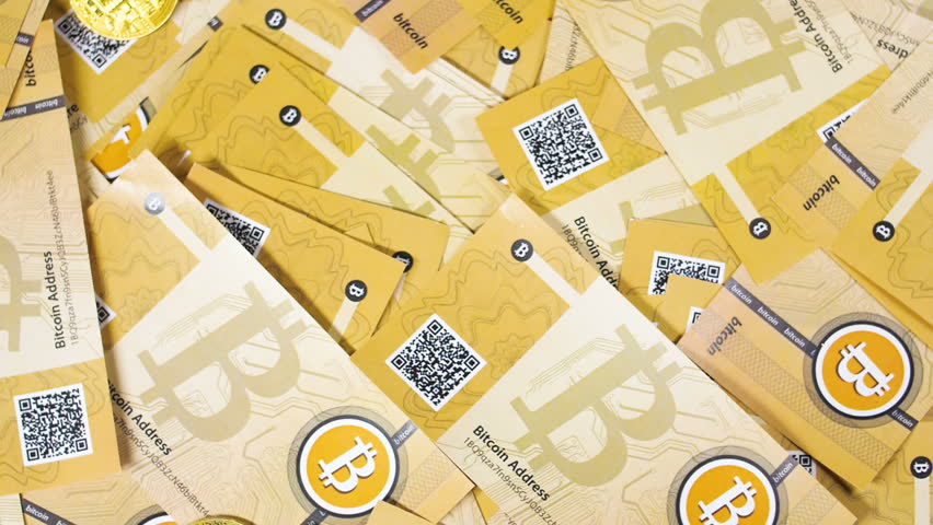 Macro upper view anonymous digital currency bitcoins and litecoins real models fall down on banknotes | Shutterstock HD Video #1010180585