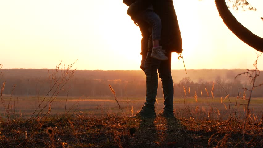 Silhouettes mother and baby sunset | Shutterstock HD Video #1010222825