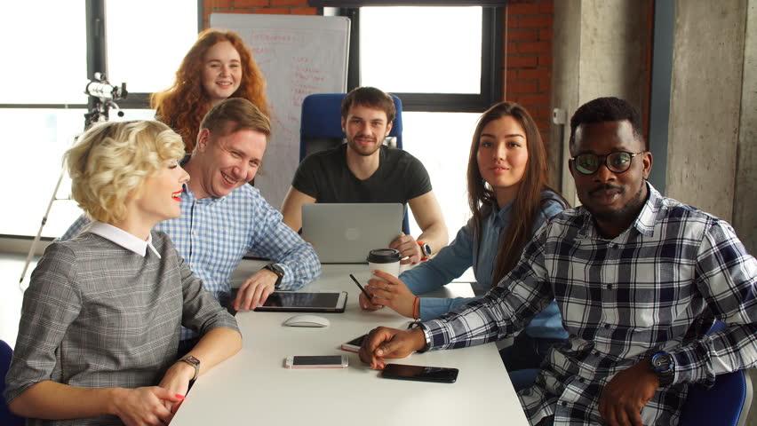 Portrait of happy young business team in modern office. Work in loft interior. | Shutterstock HD Video #1010223515