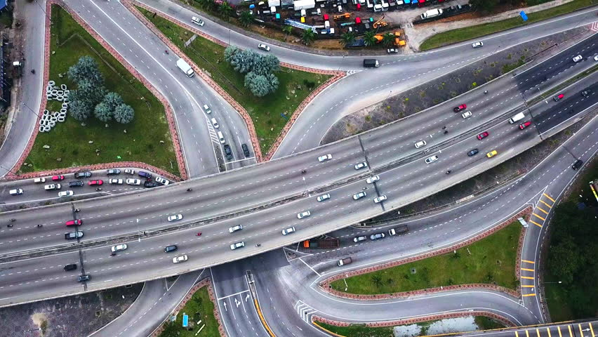 Road Traffic at highway and overpass with cars and trucks, interchange in Kuala-Lumpur,Malaysia | Shutterstock HD Video #1010224565