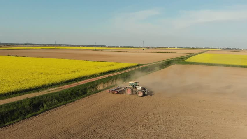 Aerial of tractor on harvest field (top view from side)  | Shutterstock HD Video #1010258165