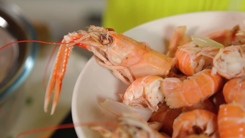 A close up shot of prawns to be prepared for cooking a meal out of it. | Shutterstock HD Video #1010269355