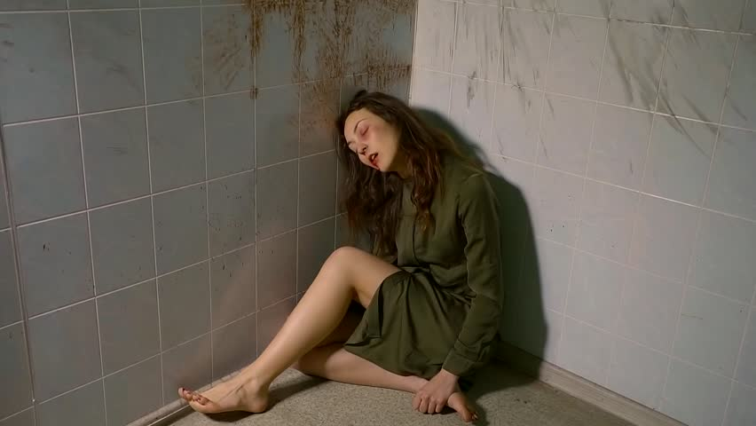 mentally ill young girl huddled in the corner of the room and be in poor condition. attack psychiatric.