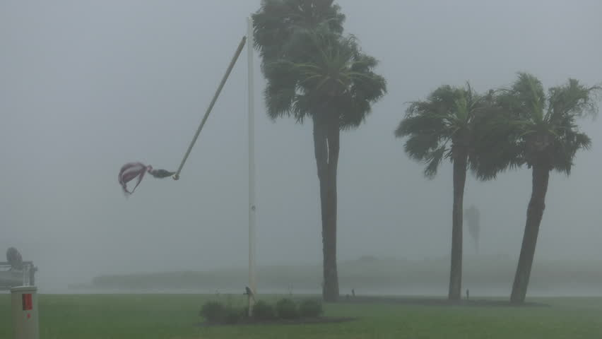 Rockport, TX/US - August 26, 2017 [Major Hurricane Harvey making landfall in Rockport, Texas. Hurricane winds, storm surge flooding along the coastal homes. Snapped flagpole in wind.]