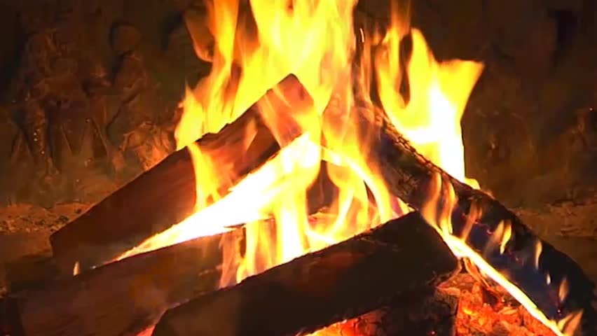 Excellent satisfying close up shot on wood burning slowly with orange fire flame in cozy brickwork fireplace atmosphere. Rural life. Burning chop wood in the stone fire-place from fire-bricks. 4K.