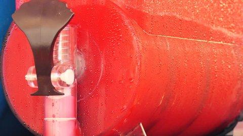Red slush. Slush puppy machine.