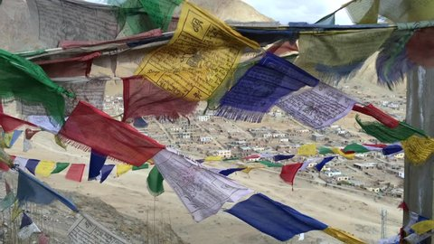 Buddhist colorful prayer flags blow by the wind in the mountains at Leh, Ladakh, India