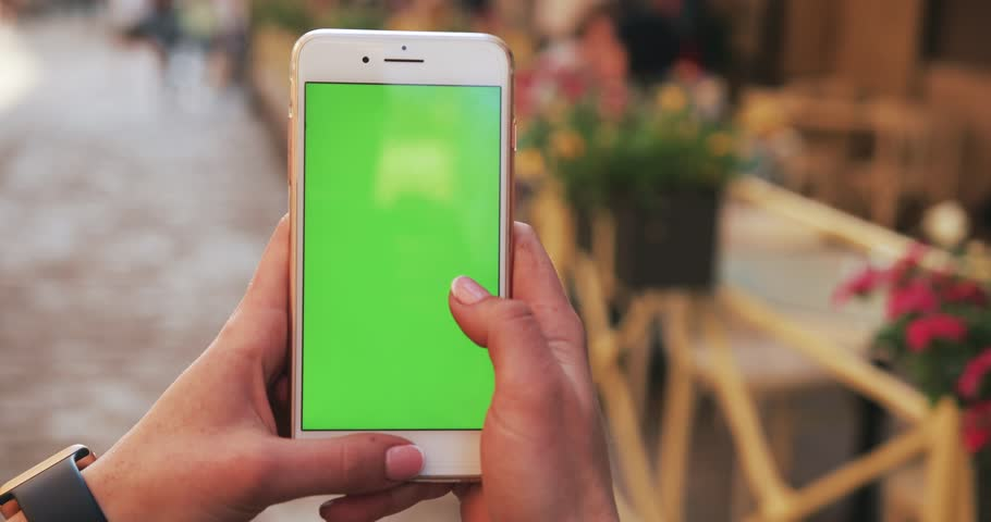 NEW YORK - April 5, 2018:hands woman holding use white phone with vertical green screen on busy street scrolling pages swiping surfing internet technology smartphone chroma key message mobile phone | Shutterstock HD Video #1010521205
