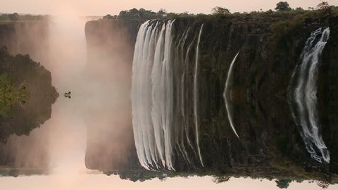Victoria Falls at sunset, View from Zambia with mystic reflection