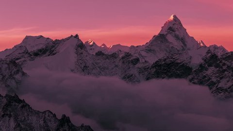 Greatness of nature concept: grandiose view of Ama Dablam peak (6812 m) at sunrise. Nepal, Himalayan mountains. Time lapse panorama.