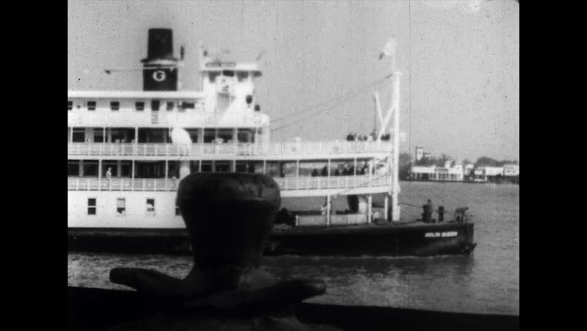 1960s: Riverboat goes down Mississippi. House on shore as boat goes by. | Shutterstock HD Video #1010609195