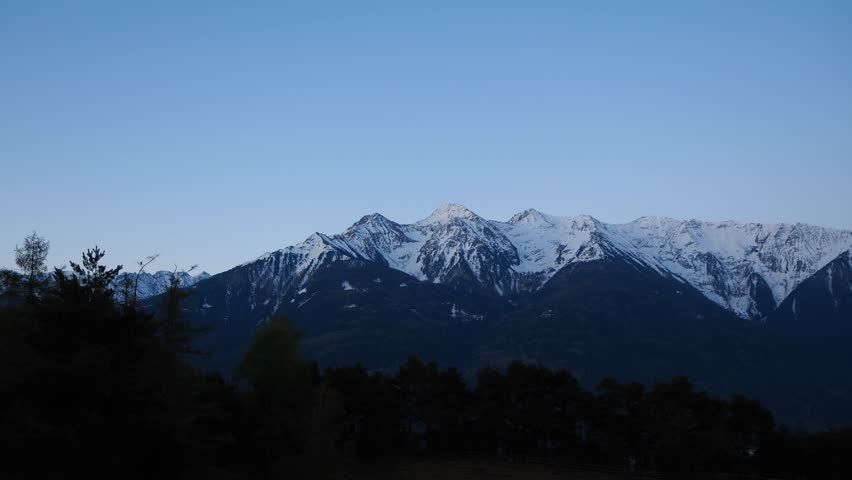 Time lapse on the peaks of the Alps still snowy in the spring | Shutterstock HD Video #1010626775