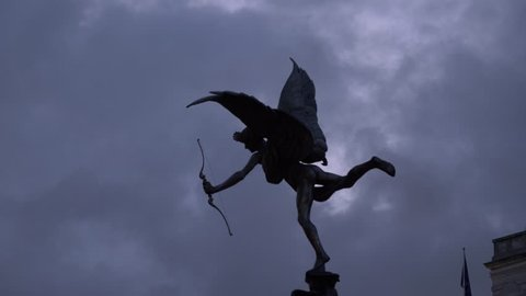 Bronze Eros Statue Located On Piccadilly Circus, Night In London, Uk, 4K