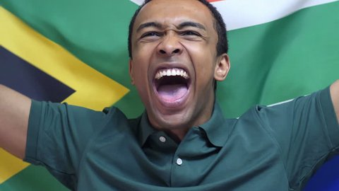 South African Fan celebrates holding the flag of South Africa in Slow Motion