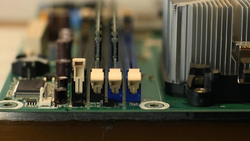 A computer repair technician installing memory modules