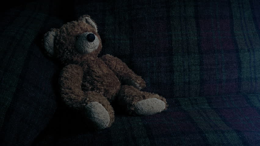 TV Glows On Couch And Teddy - Empty Room Concept