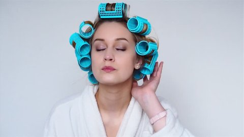 Girl wearing hair rollers getting ready for going out