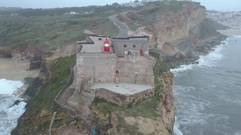 View of Nazare's lighthouse in Zon North Canyon, place with the biggest waves in Europe Nazare, Portugal