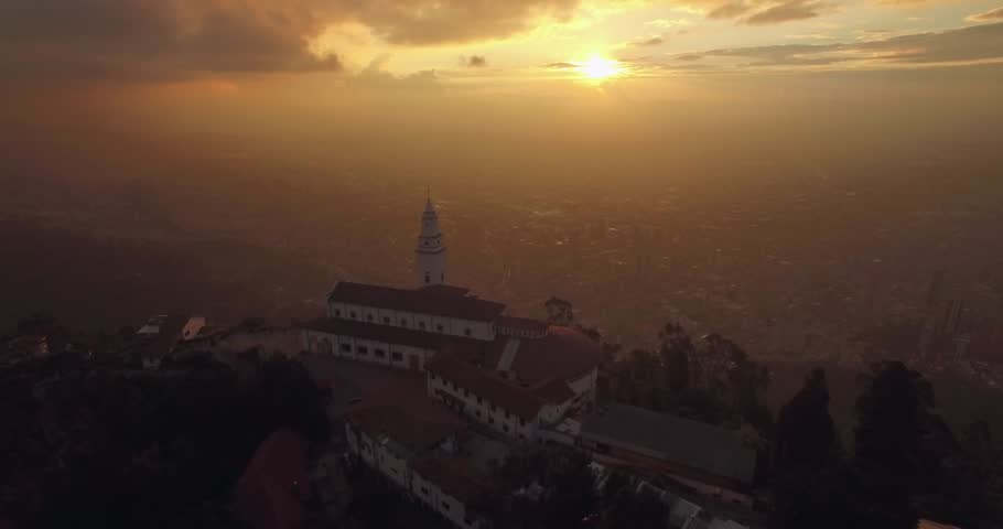 Sunset aerial flying over Monserrate Church in Bogota Colombia with the city below | Shutterstock HD Video #1010811335