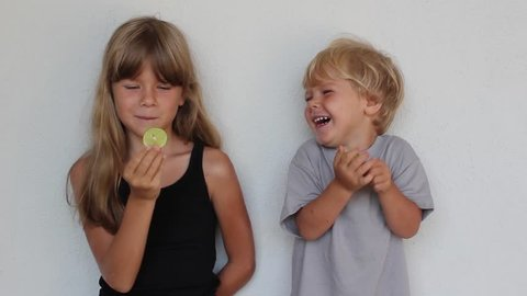 Brother and sister eating lime