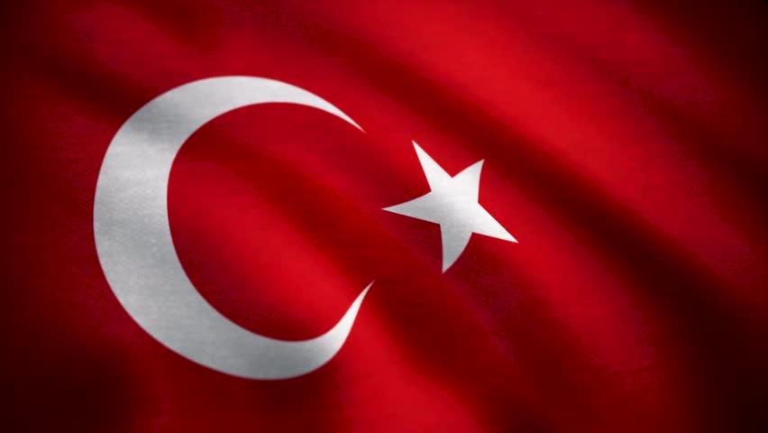 Grunge colorful background, flag of Turkey. Close-up, fluttering downwind. Flag of Turkey background