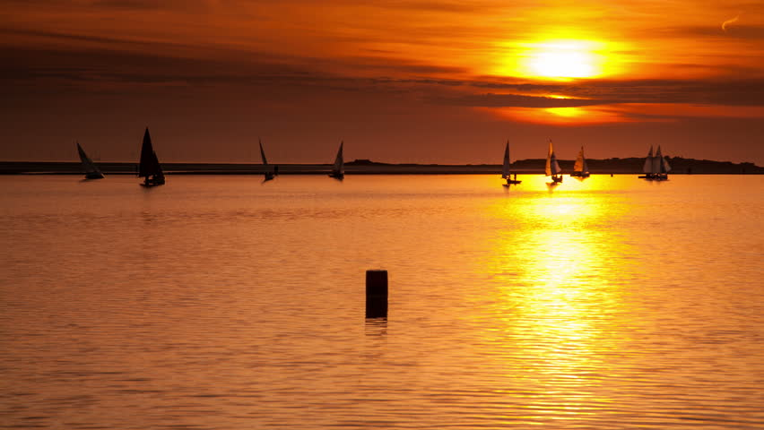 4k time lapse of yachts sailing at sunset on the West Kirby Marine Lake, Wirral, England