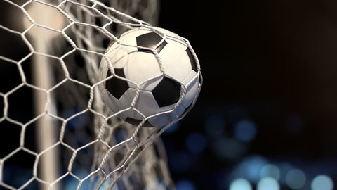 Soccer ball flies into the net on a stadium with yellow and blue lights. In slow motion. Close-up (4k, 3840x2160, ultra high definition)