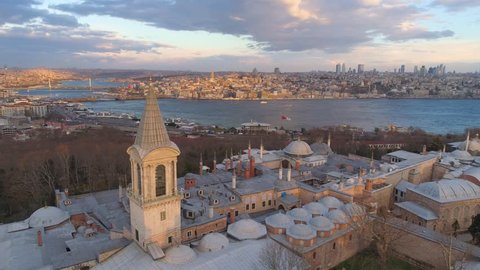 Aerial drone shot of sunrise in Istanbul, Turkie. From above, city centre, downtown. European part of the city, historical place. Topkapi palace.